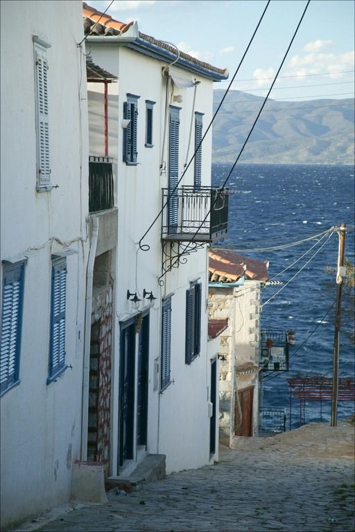 Quaint fishing village street, with the Peloponnese (or Peloponnesus) peninsula in distance & this is really, exactly how greece looks, i didnt want to leave.:( :) but i would love to visit there again!!
