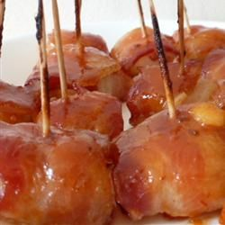 Bacon wrapped water chestnuts with a sweet glaze...YUMMY.  Original recipe given to me by my friend Cari Vales...but, this recipe is identical.  www.allrecipes.com