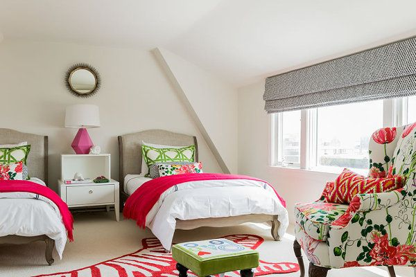 Lattice-print pillows in a tropical bedroom