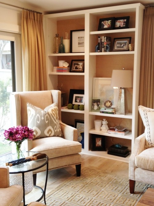 Living room shelving. Buy shelves and knock the back out. A great way to decorate without Putting holes in the wall. click for a free video