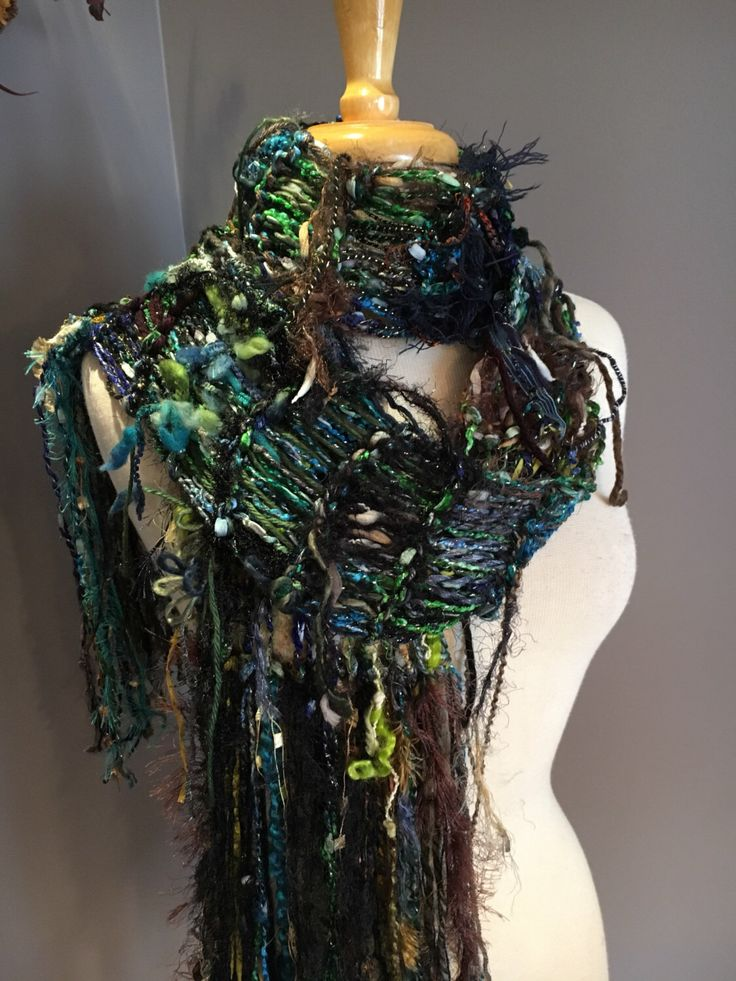 A personal favorite from my Etsy shop https://www.etsy.com/listing/505057541/knit-fringe-art-scarf-dumpster-diva