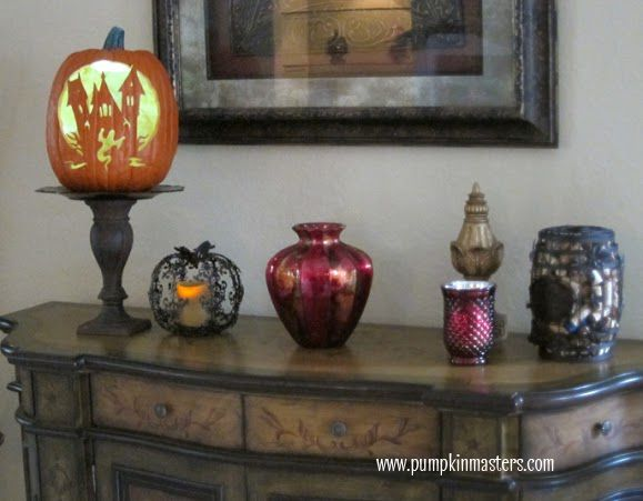 carve a haunted house into the side of an artificial pumpkin in order to save your