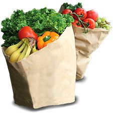 grocery bags filled with fruits and vegetables image