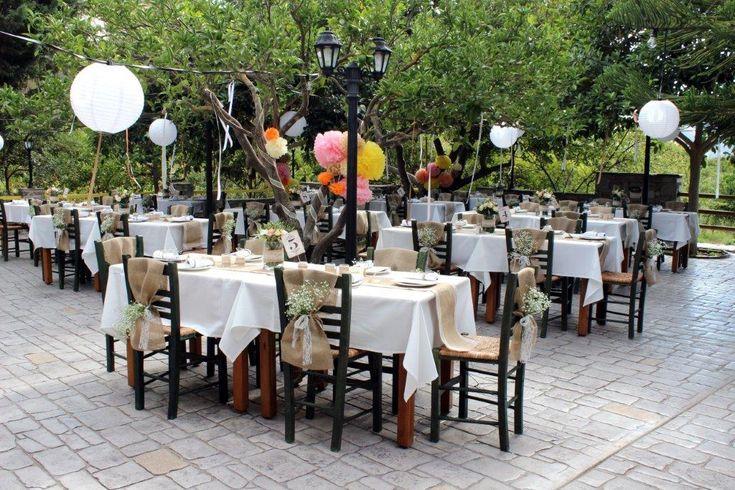 vintage burlap table runners in a greek island garden setting - light balls - pom poms and trees #destinationwedding #greekislandweddings #naxosweddings