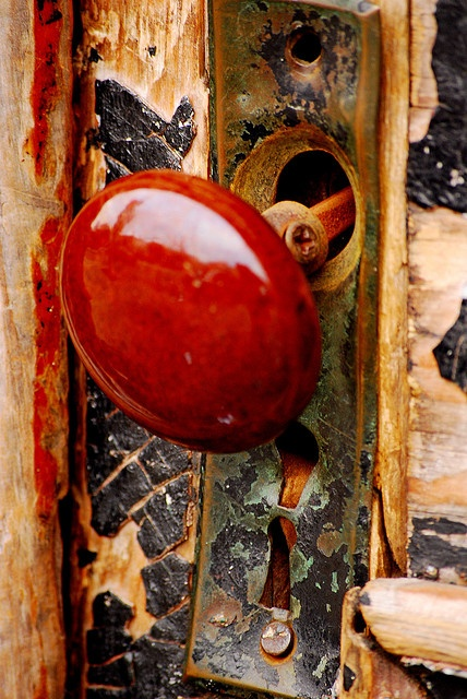 Wooden door with a red knob ~ Photo by...Kelly Barbieri©