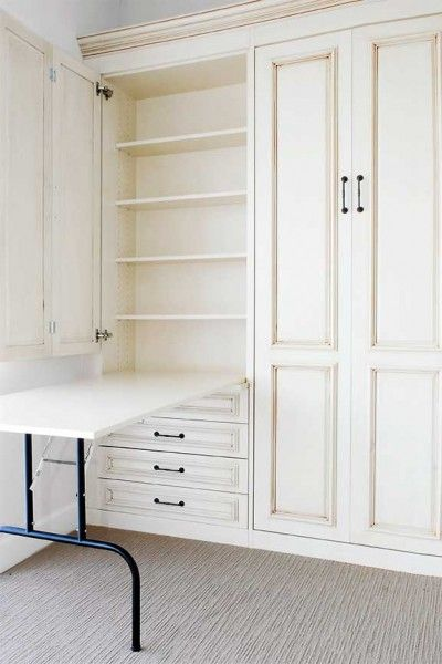 """If you're tight on space, this """"murphy table"""" is perfect for a craft room. The table folds down for use, revealing storage shelves. When you're done, simply fold it away and close the door."""