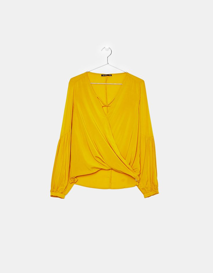 Blouse with crossover neckline. Discover this and many more items in Bershka with new products every week