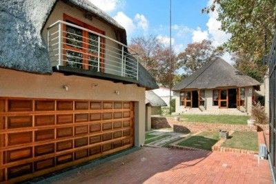 Think about your choices- Consists of large 4 bedroom 3 bedroom thatch home on level ground in secure boomed enclosure. With 3 external self-contained suites. Zoning permits Guest House use, if desired. A distinctive earthy African feel with top end finishes, this home provides endless opportunities.