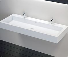 The WT-06-XXL solid surface wall mounted bathroom sink is elegance and contemporary eye-catching style that is unrivaled in its innovative and sleek modern design. The double trough wall mounted sink offers maximum impact functionality that is as aesthetically pleasing as it is practical. The shape, color and durability of this sink is striking in its simplicity. Gentle curves and smooth lines make up this unique and modern bathroom sink wall mount. The white stone resin offers pristine…