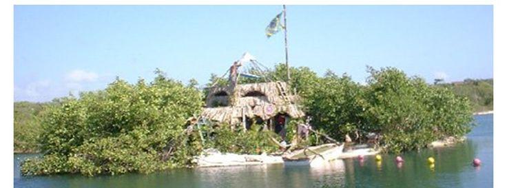 Leergutinsel: Paradies aus Abfall - Island built from trash, floating on plastic bottles.