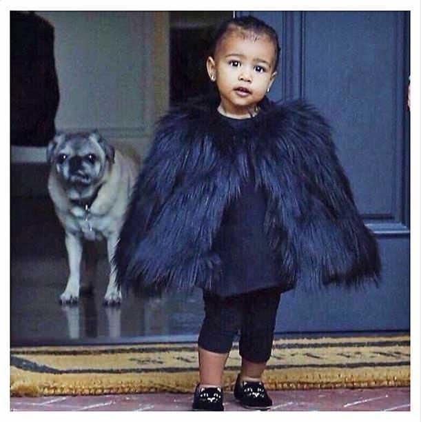 @kimkardashian/instagram We didn't think that the Kimye family would need to shop the Black Friday sales, but that didn't stop baby North West from stepping out in her all-black finest for a trip to the spa.  Momma Kim Kardashian, who often parades the styles of her daughter, instagrammed a couple posh photos of her baby girl in a miniature ostrich feathered cape and sparkly slippers to match.  North West undoubtedly stole the attention of paparazzi, as Kim followed the lead of her glamorous…