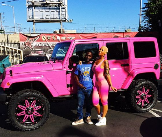 I'm not a big fan of pink, but this is super cute!   Amber Rose's Jeep.