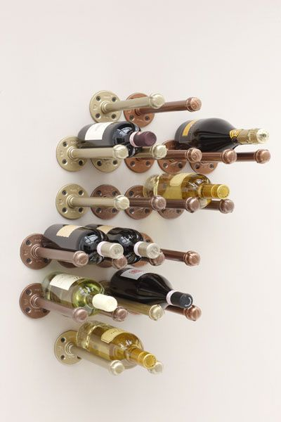 A DIY wine rack using plumbing pipes from the hardware store.  A project by Danny Seo for Everyday with Rachael Ray's September 2012 issue.