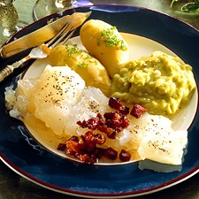 Lutefisk (ick) / with Potato or Rutabaga preferably, and aerte stuing  /  ertestuing   Mashed peas made from dried peas, sometimes w/bacon.