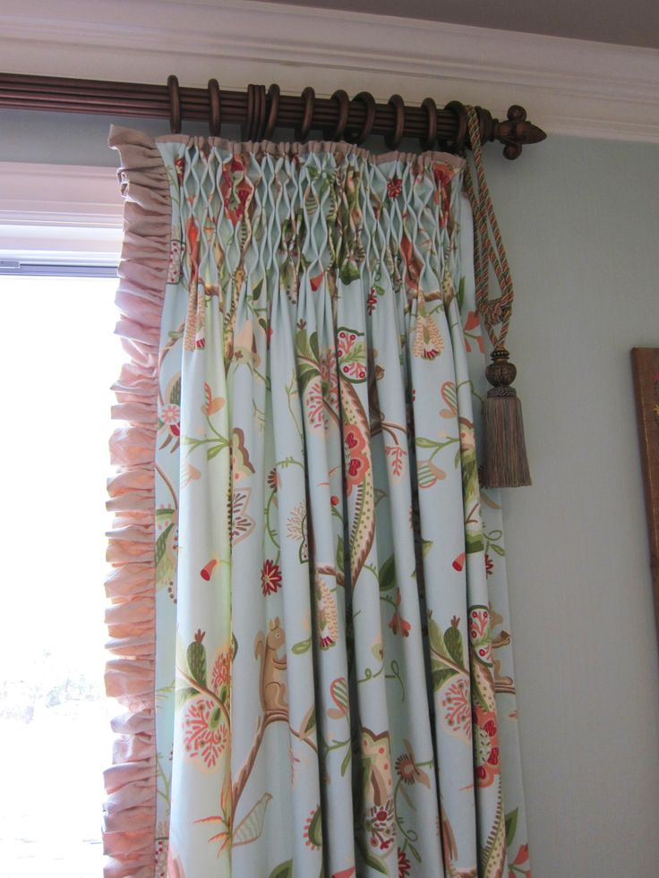 Beautiful example of smocked curtains with ruffled leading edge. Artistry-Interiors.