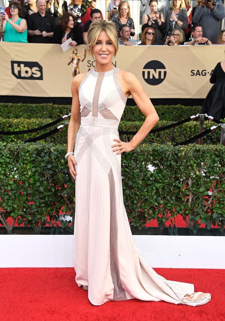 BEST: Felicity Huffman blew us away in this neutral colored gown with sheer panels throughout. It perfectly shows off those arms that even Michell Obama would be envious of! (Photo by Frazer Harrison/Getty Images) via @AOL_Lifestyle Read more: https://www.aol.com/article/entertainment/2017/01/29/sag-awards-2017-best-and-worst-dressed/21702736/?a_dgi=aolshare_pinterest#fullscreen