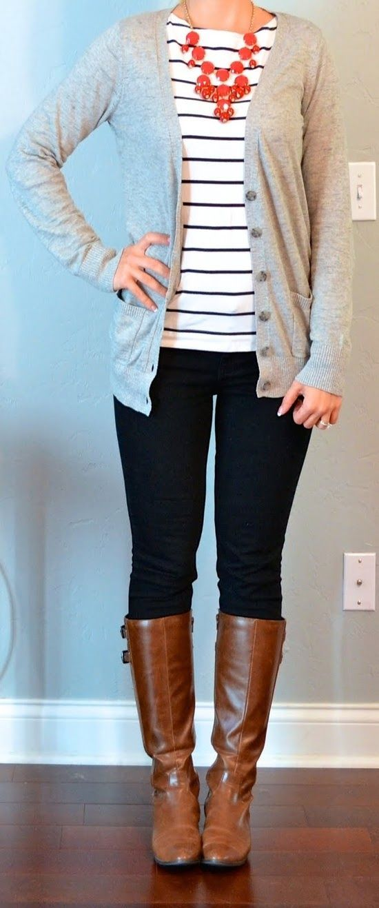 Gray cardigan, striped shirt, chunky red necklace, dark skinny jeans, knee-high brown boots.