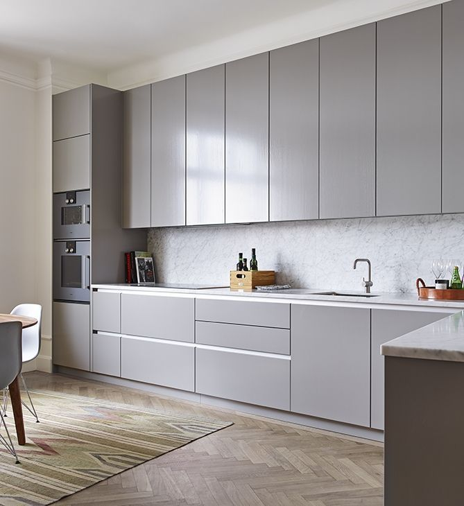 Simple grey kitchen with herringbone floor