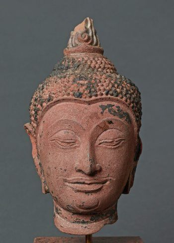 HEAD OF BUDDHA SHAKYAMUNI Catalog Number: AB916-408 Red sandstone Ayutthya Kingdom (Siam) approx. 15th to 16th cent. HEIGHT (WITHOUT BASE) 30,5 CM, BASE HEIGHT 10,2 CM
