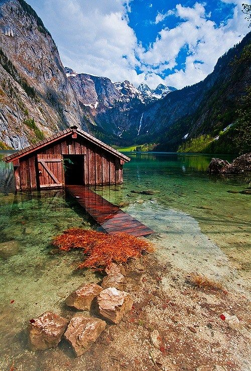 Boat house, crystal clear water in Obersee, Germany