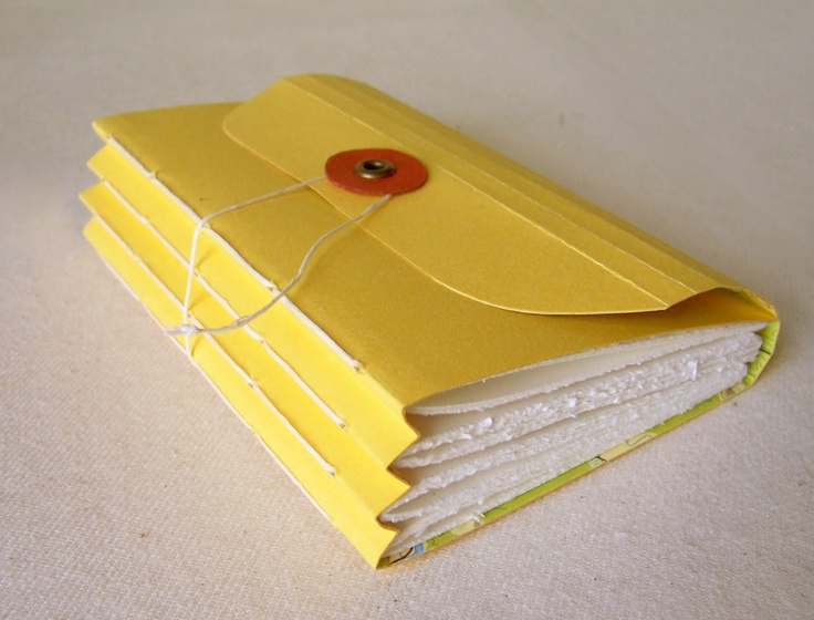 Handmade journal - 4 sections of pages sewn into an expanding cover  Sadly the link to this class does not work. If anyone has another link for a similar project I'd love to have it.