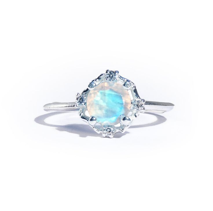 Handmade solid 10ct whitegold ring set with beautiful 6mm Rainbow Moonstone  and four white diamond halo. The perfect ring.  Diamonds are conflict free.  Also available in solid yellow gold.        All pieces are made to order therefor please allow up to 7-10 working days  until your order is shipped.