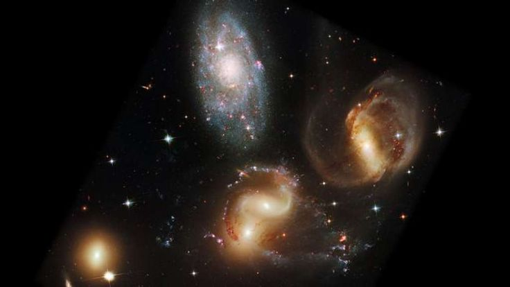 NASA caption: This portrait of Stephan's Quintet, also known as Hickson Compact Group 92, was taken by NASA's Hubble Wide Field Camera 3 (WFC3). Stephan's Quintet, as the name implies, is a group of five galaxies. However, studies have shown that group member NGC 7320, at upper left, is actually a foreground galaxy about 40 million light-years from Earth. The other members of the quintet reside 290 million light-years away. Three of the galaxies have distorted shapes, elongated spiral arms…