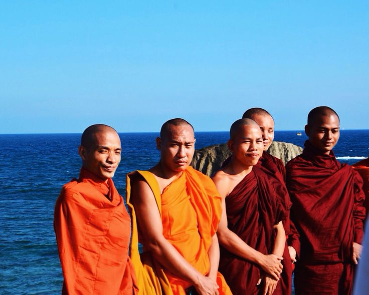 buddhist monks and blue sky at Galle