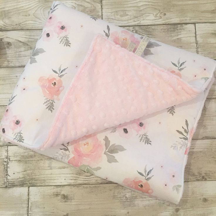 Sweet Roses baby blankets backed with a super soft dimple plush in a choice of colours. Perfect finishing touch for a vintage floral style nursery.