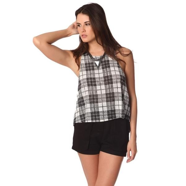 Black smock top in a light-woven fabric with a mono check print. Halter neck styling with no sleeves and relaxed fit. Button closure on the back with a keyhole detail. Perfect to combine with a black short!