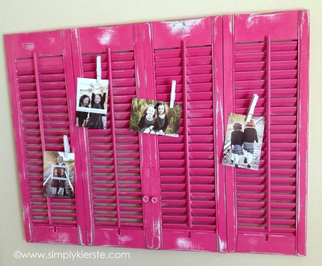 Old shutters turned display board for little girls bedroom. Personalized clothes pins to hang photos and artwork.