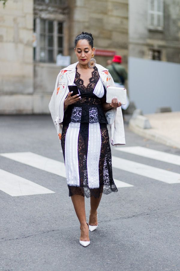 Tracee Ellis Ross outside Rodarte during Paris Fashion Week in a black and white lace dress | ESSENCE.COM