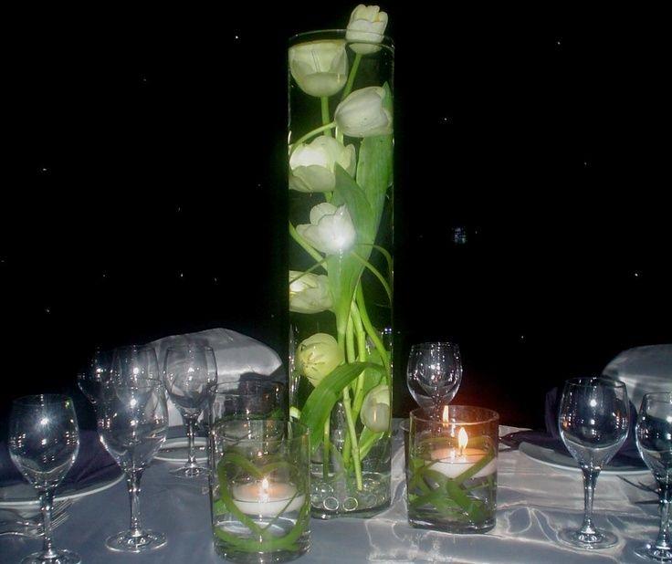 encuentra este pin y muchos ms en centros de mesa con velas grandes de