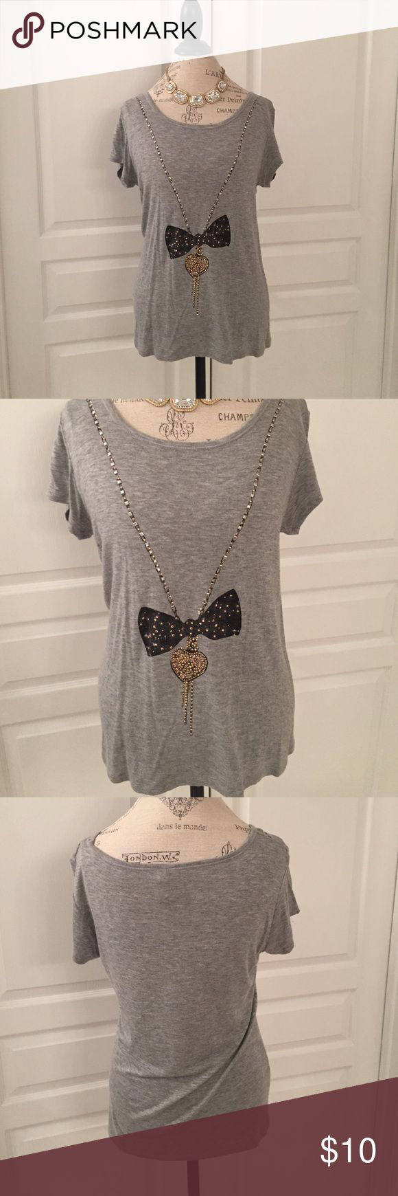 Grey Slouchy Bow Necklace Tee Adorable, soft tee with bow necklace detail. With cute rose gold accents. Worn less than 10 times. Size medium. Charming Charlie Tops Tees - Short Sleeve