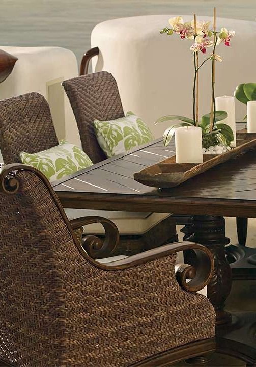 Resembling it's namesake tropical island, the St. Martin Dining Collection brings coastal elegance to your outdoor space with it's durable walnut construction and all-weather wicker seating.