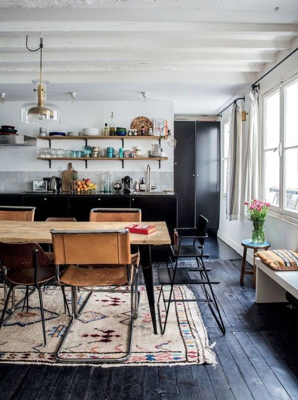dark floors and kitchen with bohemian eclectic styling in the dining room | via coco+kelley