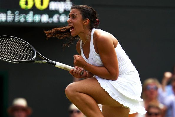Marion Bartoli Photos - Marion Bartoli of France celebrates after winning her fourth round match against Serena Williams of the United States on Day Seven of the Wimbledon Lawn Tennis Championships at the All England Lawn Tennis and Croquet Club on June 27, 2011 in London, England. - The Championships - Wimbledon 2011: Day Seven