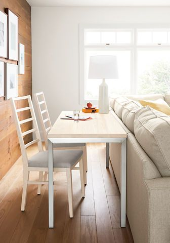 I love the idea of a small table/desk behind the couch for extra seating or as a small desk for paying bills, etc.