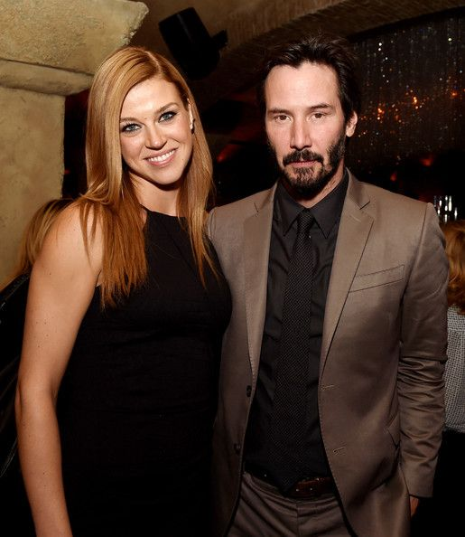 """Keanu Reeves Photos Photos - Actors Adrianne Palicki (L) and Keanu Reeves pose at the after party for the screening of Lionsgate Films' """"John Wick"""" at the Roosevelt Hotel on October 22, 2014 in Los Angeles, California. - US Entertainment Best Pics of the Day"""