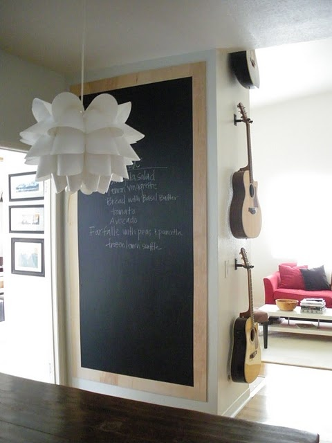 Chalkboard, guitars- one of my favorite home projects. It was really fun to see how a dramatic gesture (oversized chalkboard) could make use of a previously unnoticed wall.