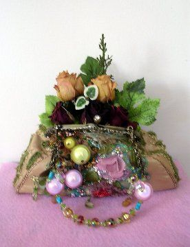 Fancy Purse Planter Craft....use old purse and artificial flowers and beads and leaves great for a lil whimsy in your home