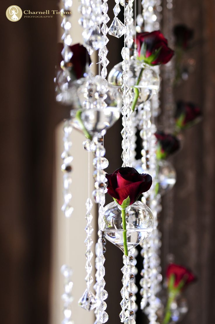 Wedding roses draped along the reception walls. Charnell Timms Photography