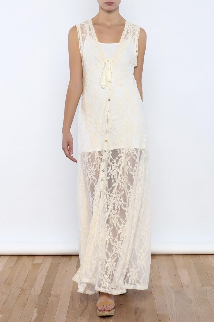 Sheer lace dress with floral embroidery button front closure and front ties. Tank is not included.  Sheer Lace Dress by Bacio. Clothing - Dresses - Casual Clothing - Dresses - Maxi Nolita Manhattan New York City