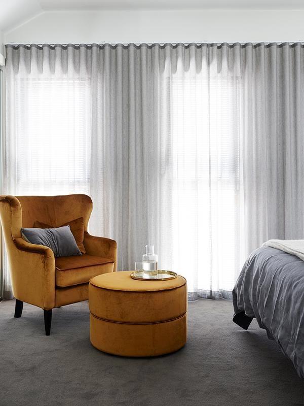 Ripplefold curtains in sheer grey fabric