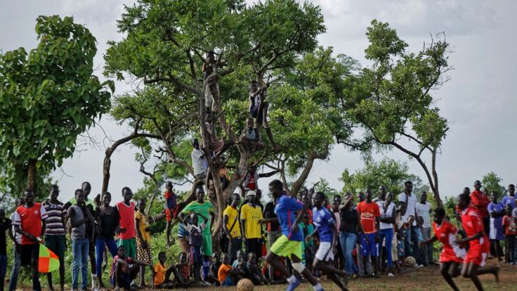 The soccer field is littered with sharp stones, but the girls who attack the ball with their bare feet play on.  Here in what has become the world's largest refugee settlement, youth from South Sudan are drawn to soccer, a rare source of entertainment in an otherwise dreary... - #Camp, #Drawn, #Largest, #Refugee, #Soc, #TopStories, #Worlds, #Youth
