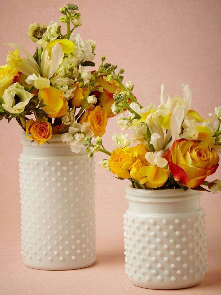 Vasos e potes de vidro decorados