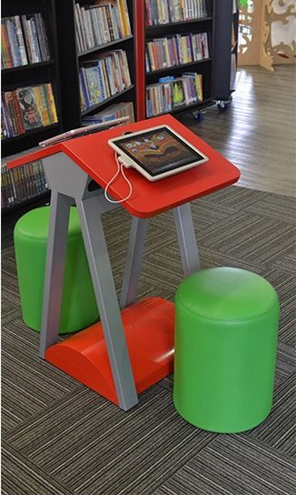 iPad table dedicated for use by children - short table and chairs with iPad secured to table.