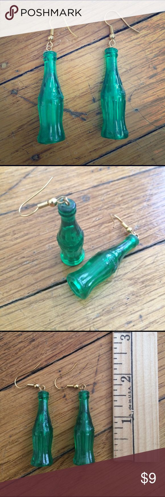 Plastic green Coke bottle earrings Drink in these cute Coca Cola bottle earrings! Hard plastic green Coke bottles just over an inch & a half tall on gold hooks to hang about 2 1/2 inches from your earlobe. Had these since childhood & it's time for them to find a new home. Clean, vintage age but basically look like new. Top-rated seller, ships daily! Questions & reasonable offers welcome. Happy poshing! ✨ Vintage Jewelry Earrings