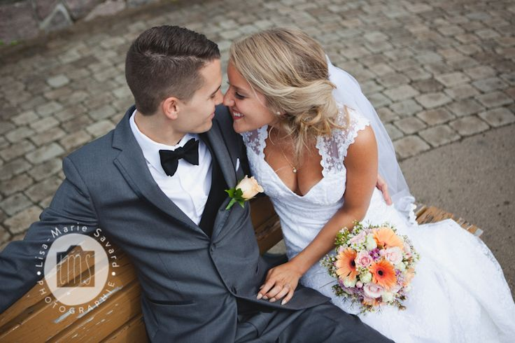 Bride and groom sitting on a bench and touching noses. Montréal Saguenay Québec. Photo: Lisa-Marie Savard Photographie