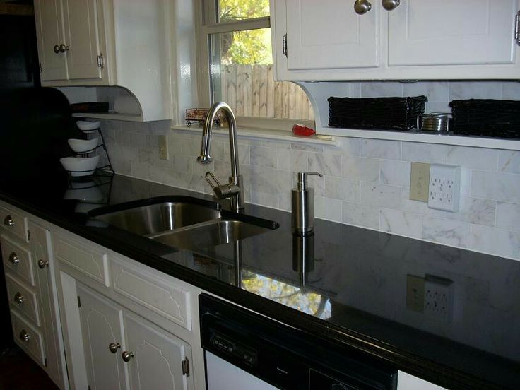 Vintage Look With X Subway Tile In White Carrera Marble Over Absolute Black  Polished Granite.